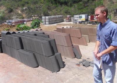 Daniel inspecting roof tiles.