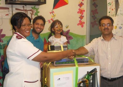 The partners present the hospital with a TV, DVD player and videos on behalf of the practice
