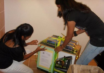 Charmaine and Praneshree wrapping up the gifts