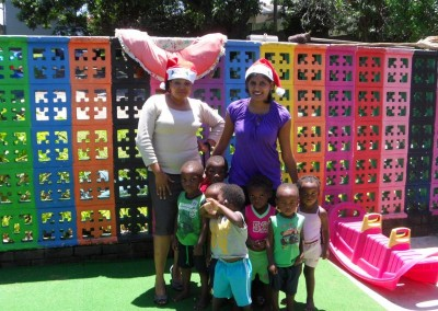 Favourite and Praneshree with some of the children in their play area