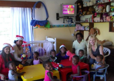 Charmaine and Favourite having fun with staff and the children