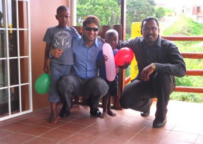 Mr Lockhat and Krishnen pose with the children at the home during the Christmas party