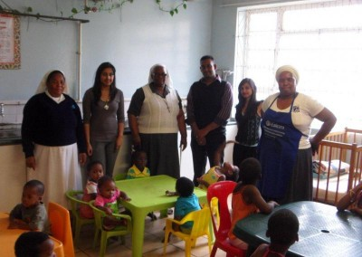 Nickara Maharaj, Vicarl Ramnot & Kajal Lalmun with staff and children from the Assisisi Home