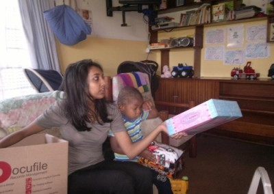 Coastal Accounting Staff handing out gifts to the children