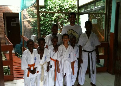 Ahmed poses with some of the children